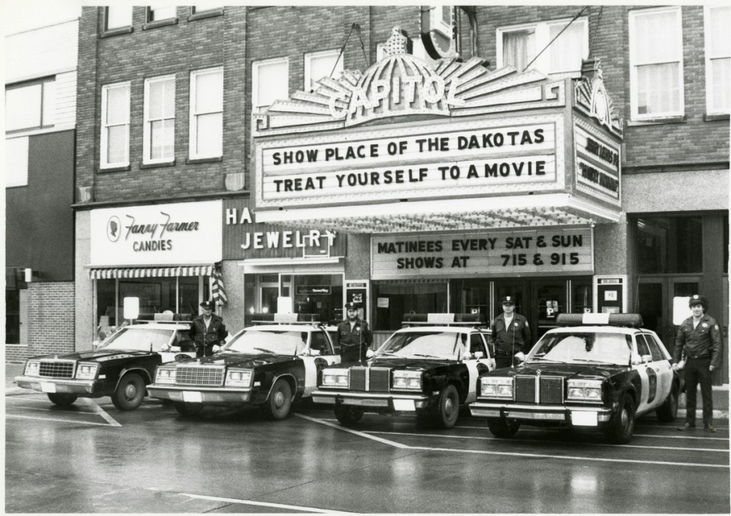 Policemen in front of the Capitol Theater